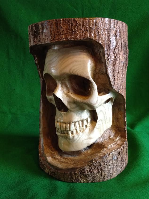 This brilliant skull tree carving was sent in by dino