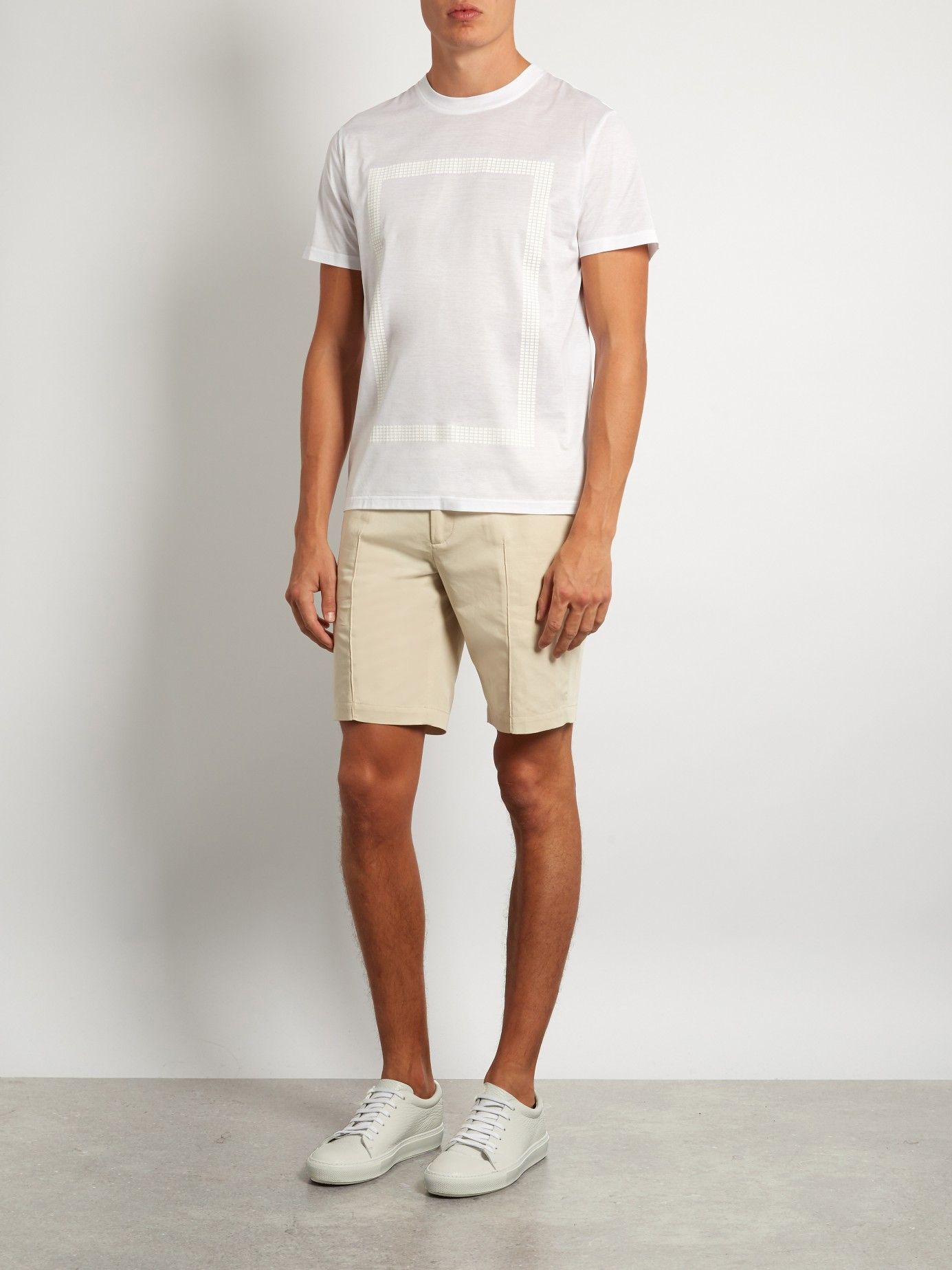 Elevate casual city looks with Calvin Klein Collection's beige Tropic chino  shorts. They're crafted from a refined blend of cotton and linen to a slim,  ...