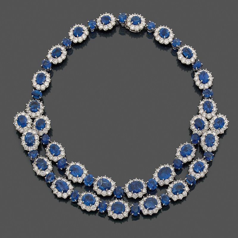 A spectacular diamond, Burma sapphire, platinum and 18K gold necklace and its matching earrings