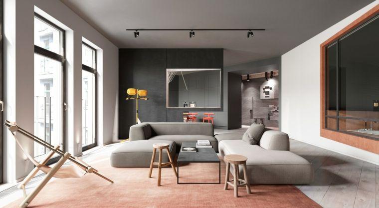 Arredamento moderno per un soggiorno con parete nera e divani