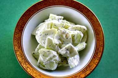 Cucumber yogurt tzatziki, a simple salad of peeled, sliced cucumbers, yogurt, dill, and salt and pepper. To accompany spicy dishes. (use fat-free yogurt)