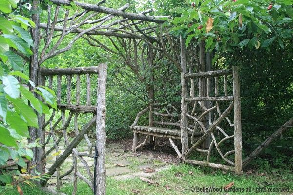Rustic arbor, fence, and bench structure.