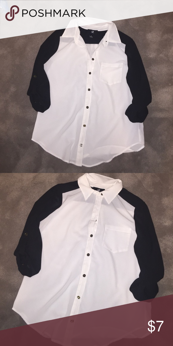 Black and white 3/4 sleeve work blouse Black and white button up 3/4 sleeve pocket blouse . Worn once Iz Byer Tops Blouses