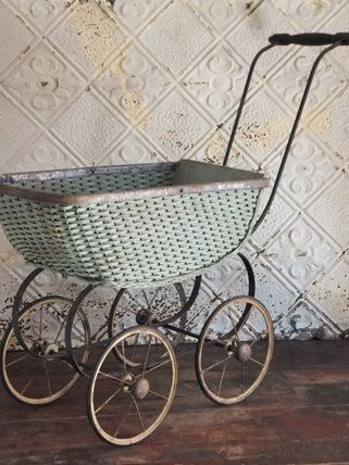 Hey, I found this really awesome Etsy listing at https://www.etsy.com/listing/249425447/antique-green-wicker-doll-carriage-buggy