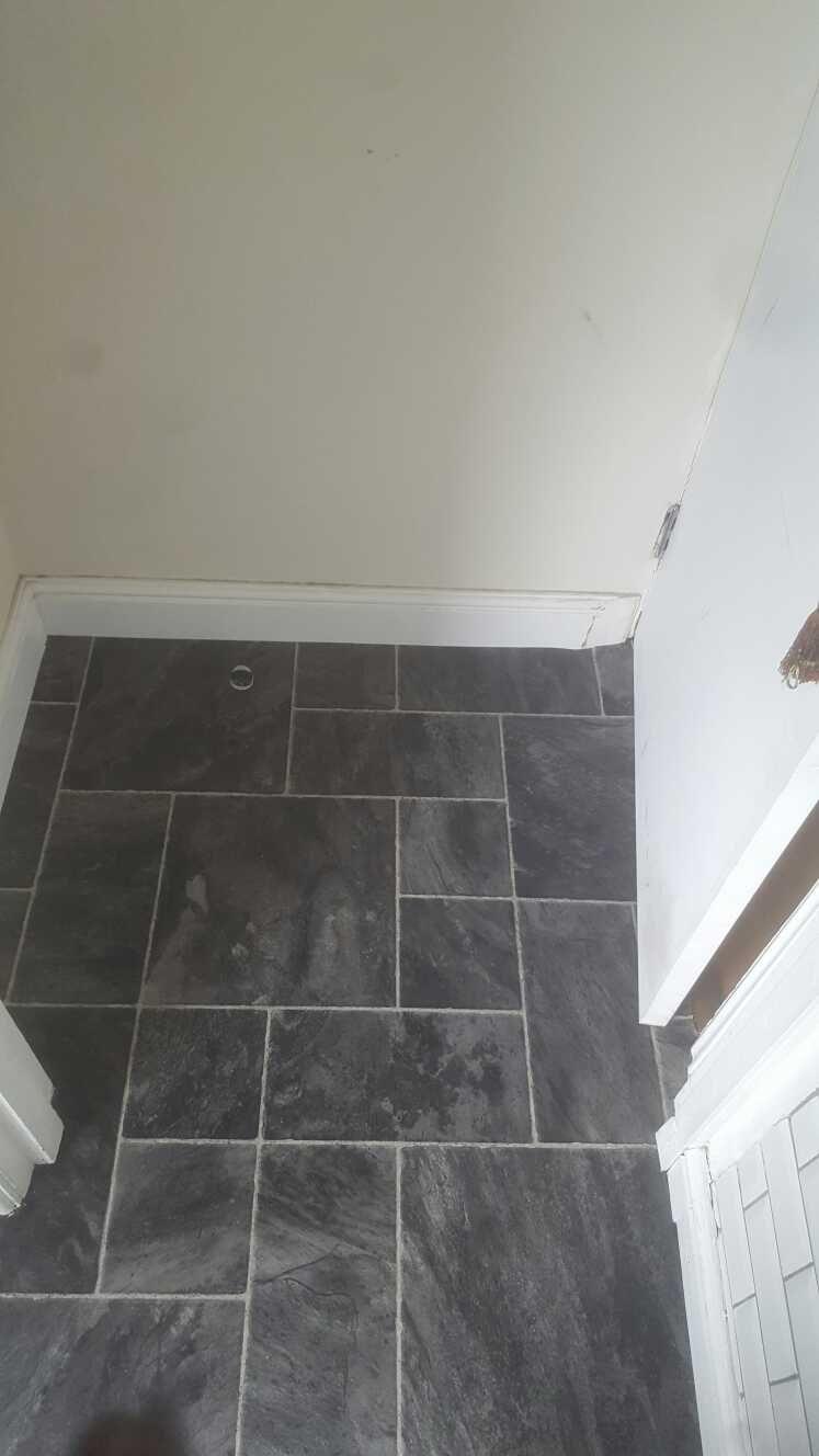 Grey tile effect vinyl floor in a bathroom | Tile effect ...
