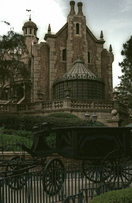 Old Creepy Mansion With Black Carriage In Front In