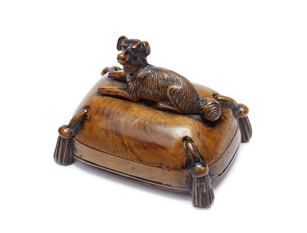 A mid-19th century carved boxwood and walnut snuff box