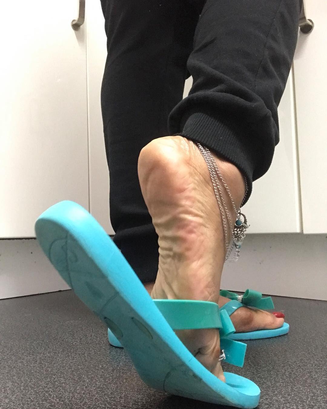 women feet showing soles sandals