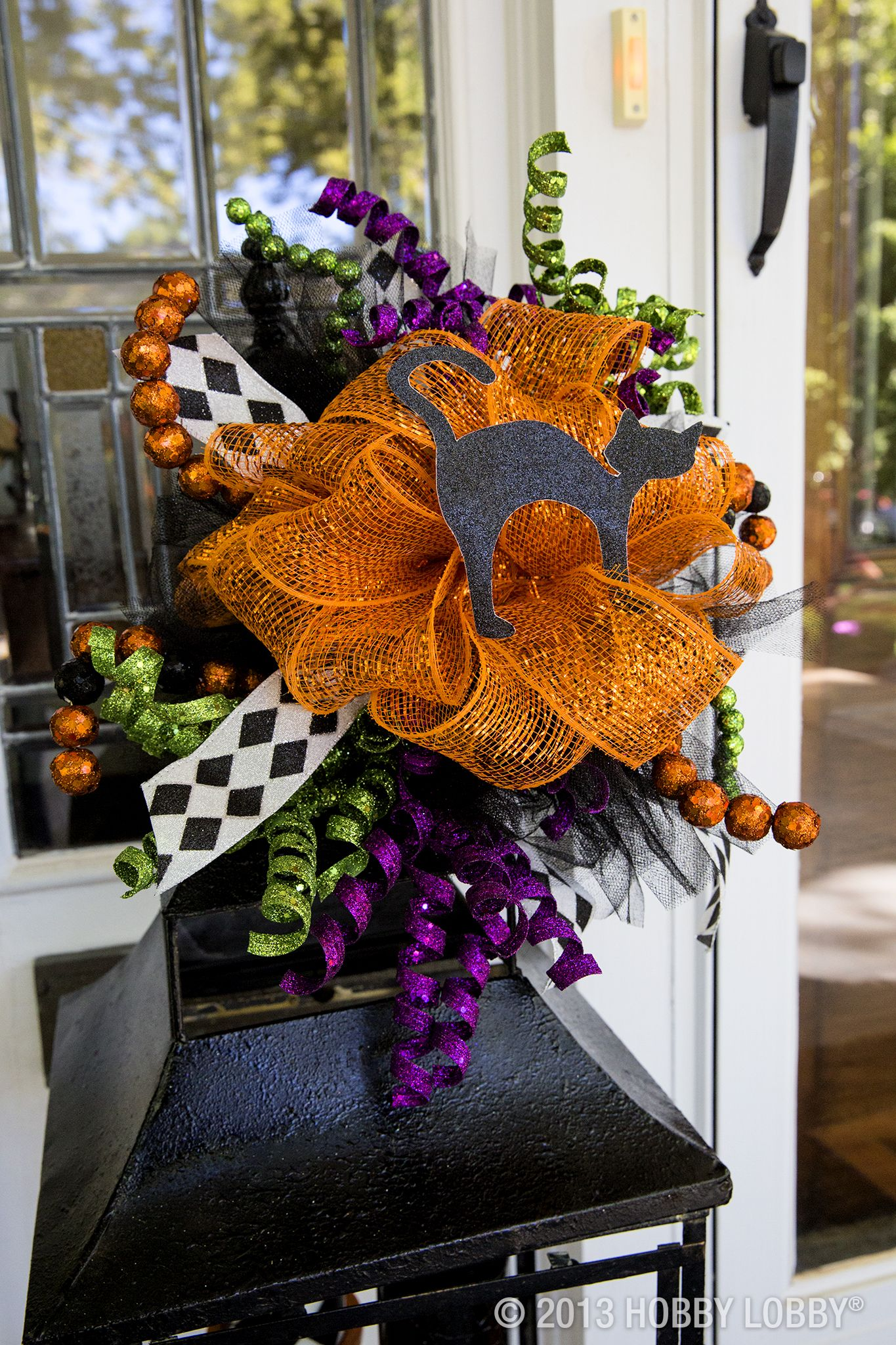 Create a wreath or ribbon arrangement that\u0027s a \