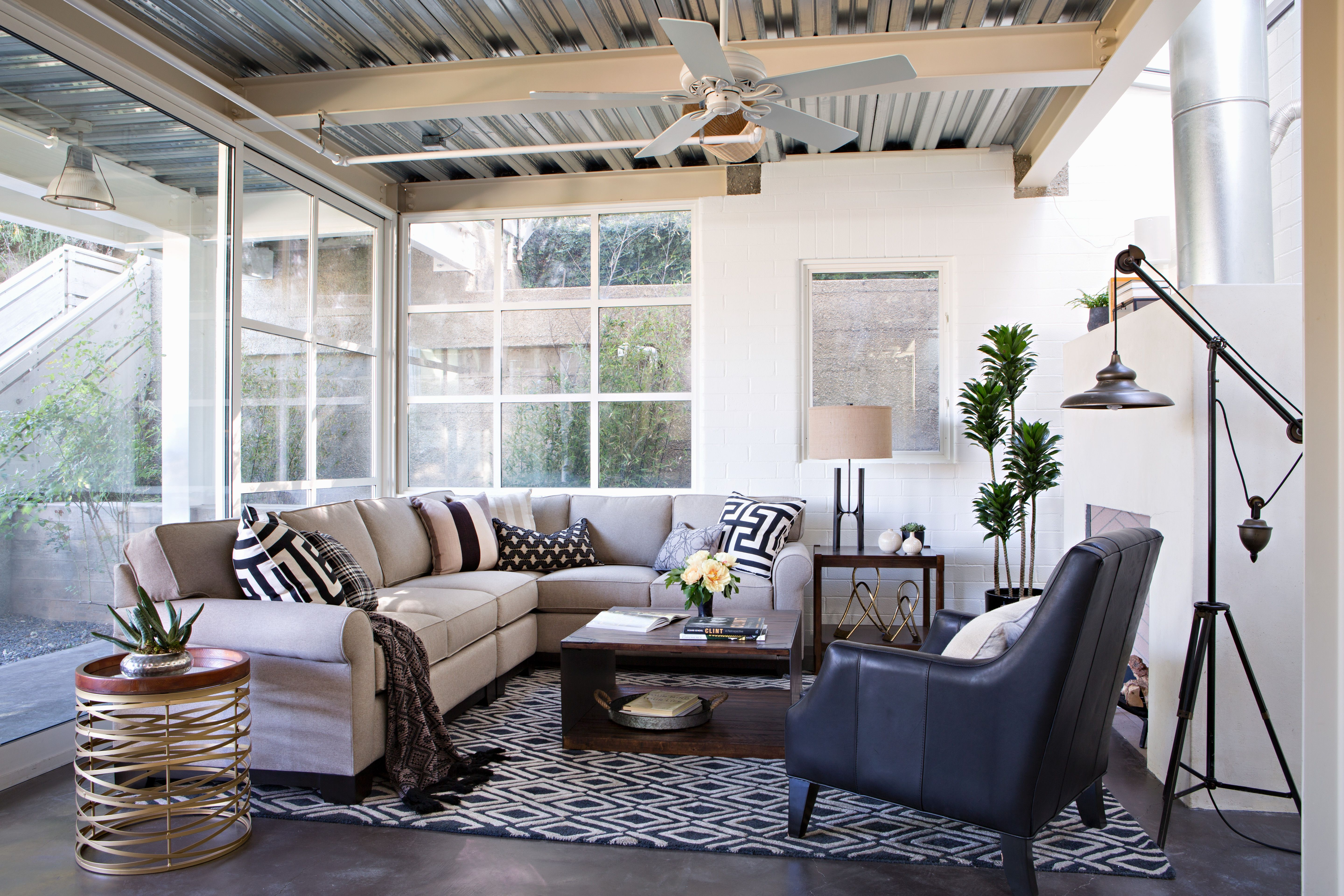 An industrial living room doesn\'t have to be dark. Add a sense of ...
