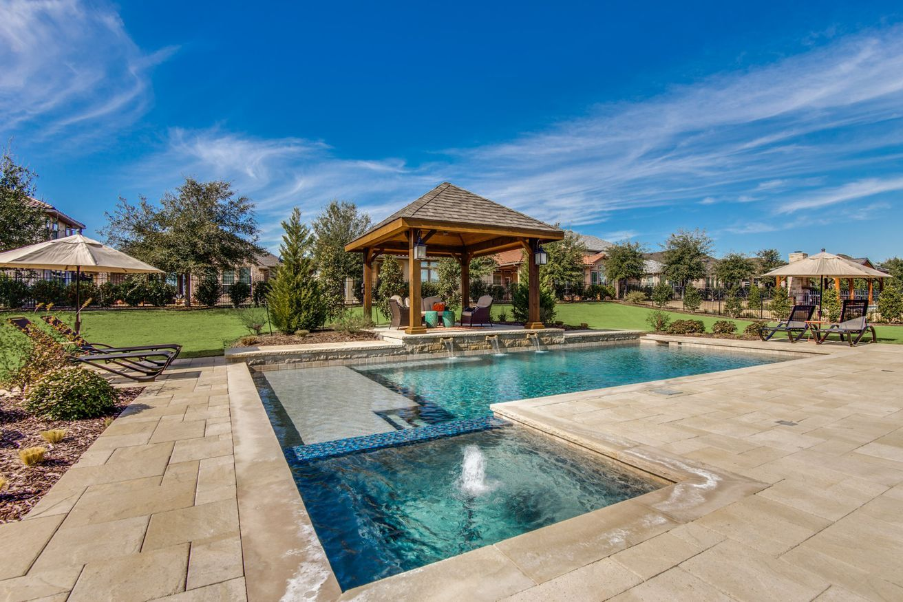 How amazing is this custom pool with tile and fountain