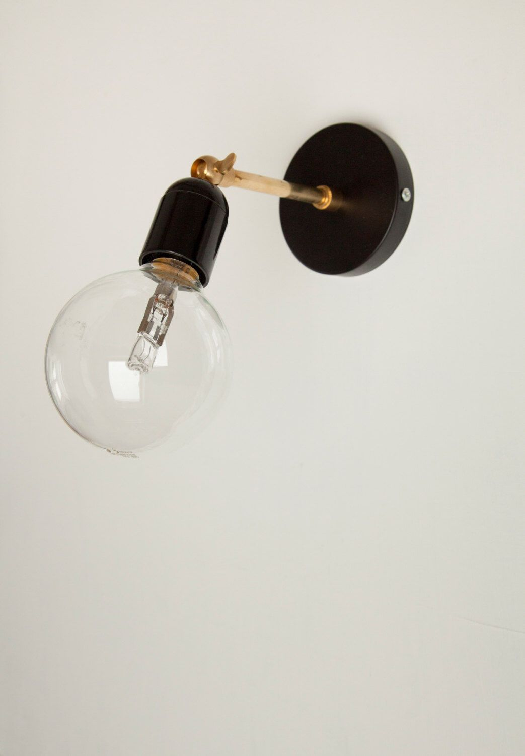 Brass Wall sconce light with black Bakelite lamp holder and brass