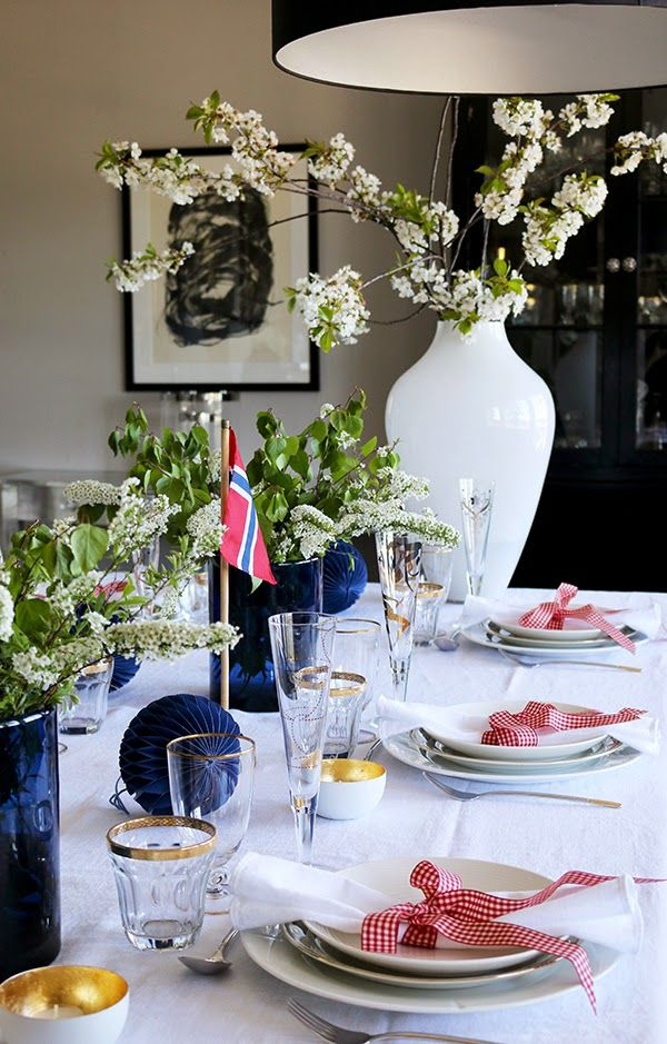 Happy Birthday to Norway! We are celebrating 17th of May, our Constitution Day. This year I decorated two different tablesetting ideas for my guests and blog followers. This year I used Spiraea cinera (Grefsheim) and branches of cherry for the table, for me the ultimate sign of spring in Norway. Clean white white crockery, napkins and tablecloth are beautiful to blue and red details. Fore more pictures, please visit my interior blog: http://anettewillemine.com/