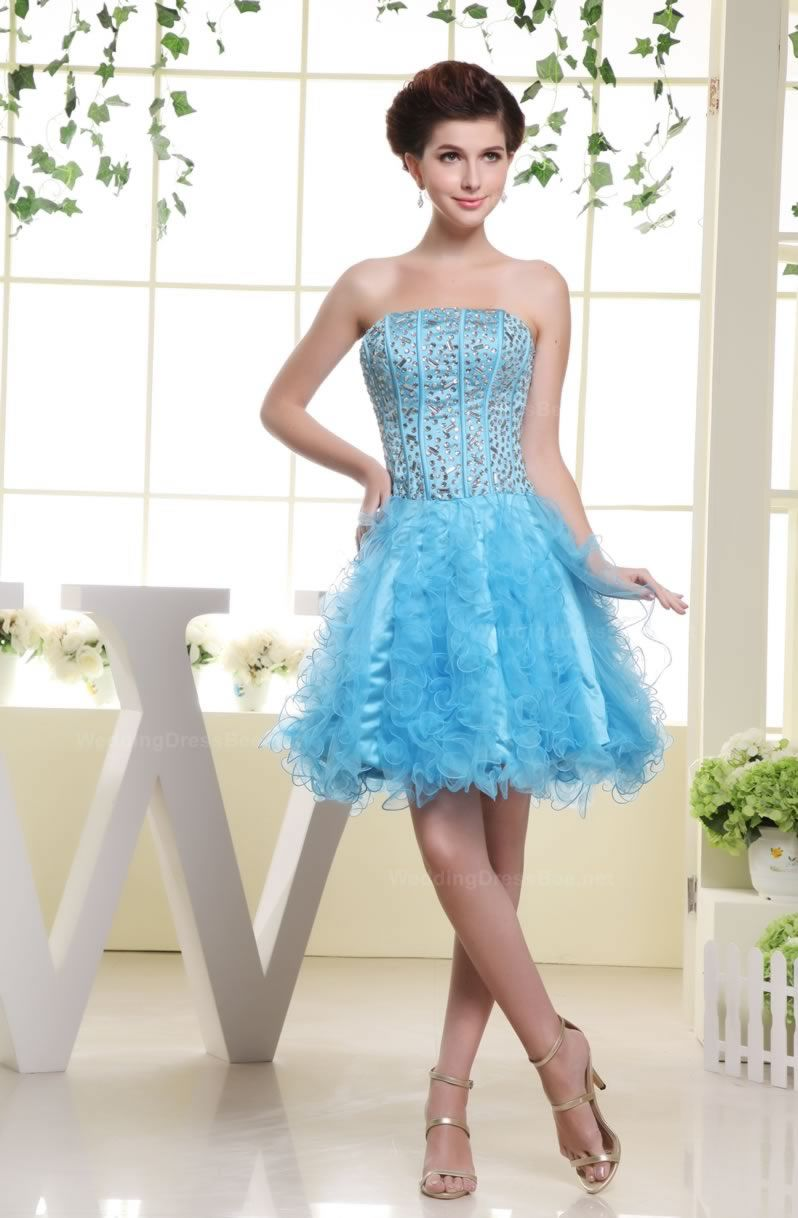 Fully boned strapless dress with rhinestones and bustled bottom ...