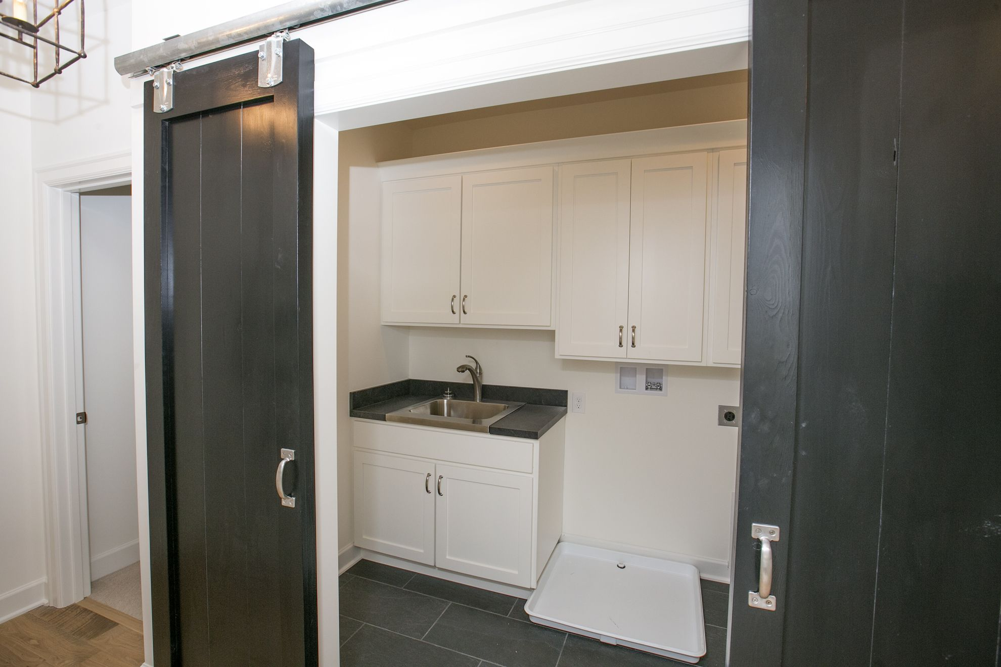 The laundry room is built into the hallway in the New