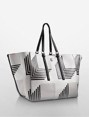 ab3174daf23 Calvin Klein Womens Darcy Reversible Loft Tote Large Stacks Print ...