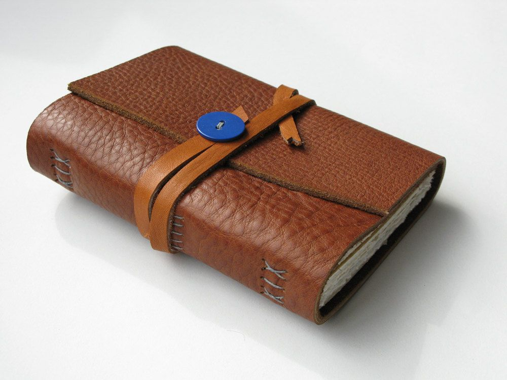 Handmade Red Brown Leather Journal with Mixed Paper, OOAK. $36.00, via Etsy. Strap sewn on with button on top of one end. Nice touch. Could do that with a charm?