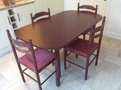 Dark wood mahogany finish dining room table and chairs with red cushion seats.   https://t.co/i4OJmQ4qak https://t.co/Hi0vdsHt5Z