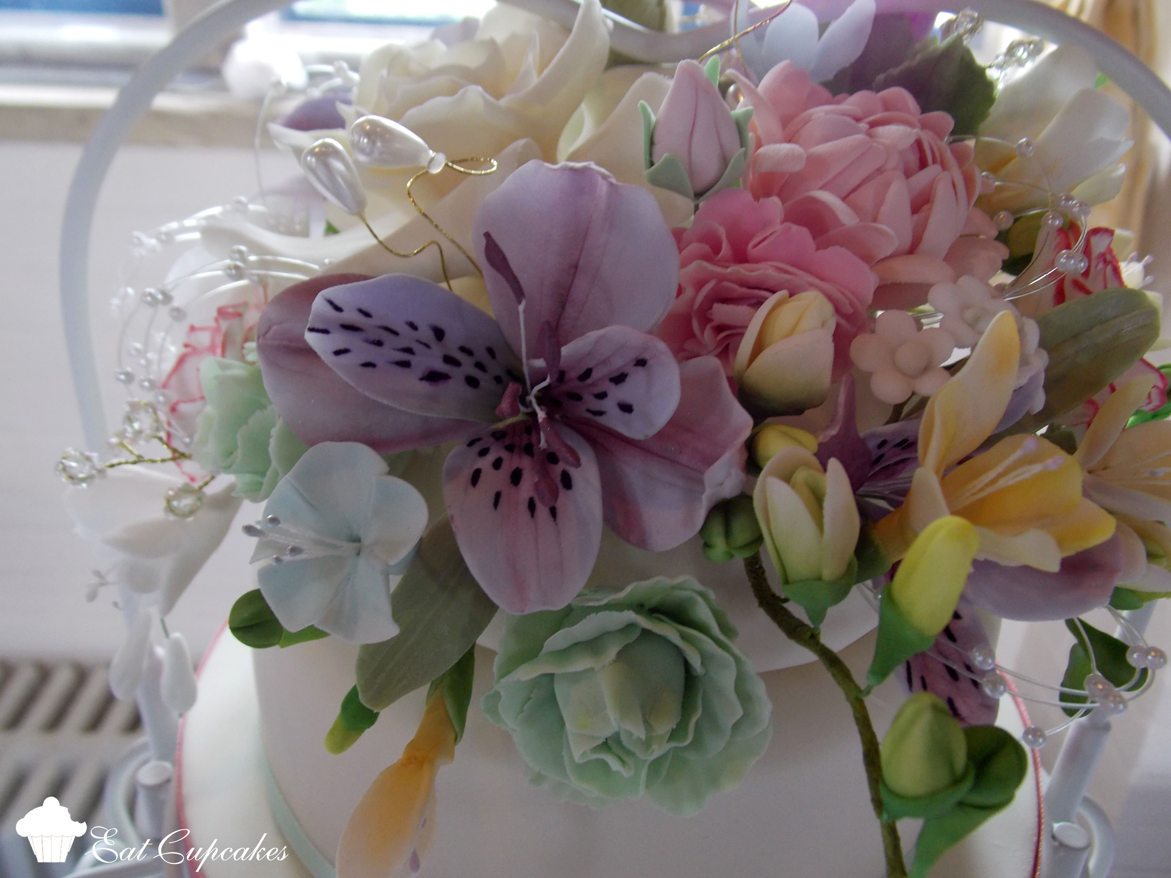 Graceful Tiers Wedding Cake Sugar Freesias, Chrysanths, Alstromeria lilies, carnations and filler flowers.