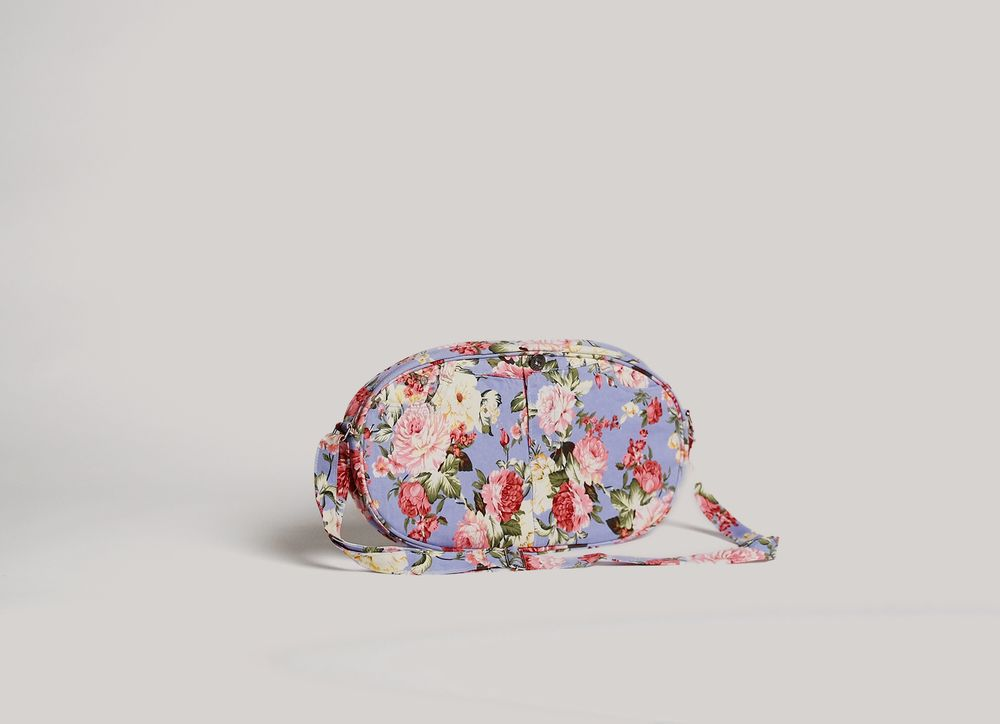 """Carry an oval blossom of nature with you this spring. Hand-crafted to carry  essentials. Perfect for everyday.  *Adjustabel shoulder strap, 18"""" drop  *Smooth oval shape  *2 outside open pocikets kept from original pants"""