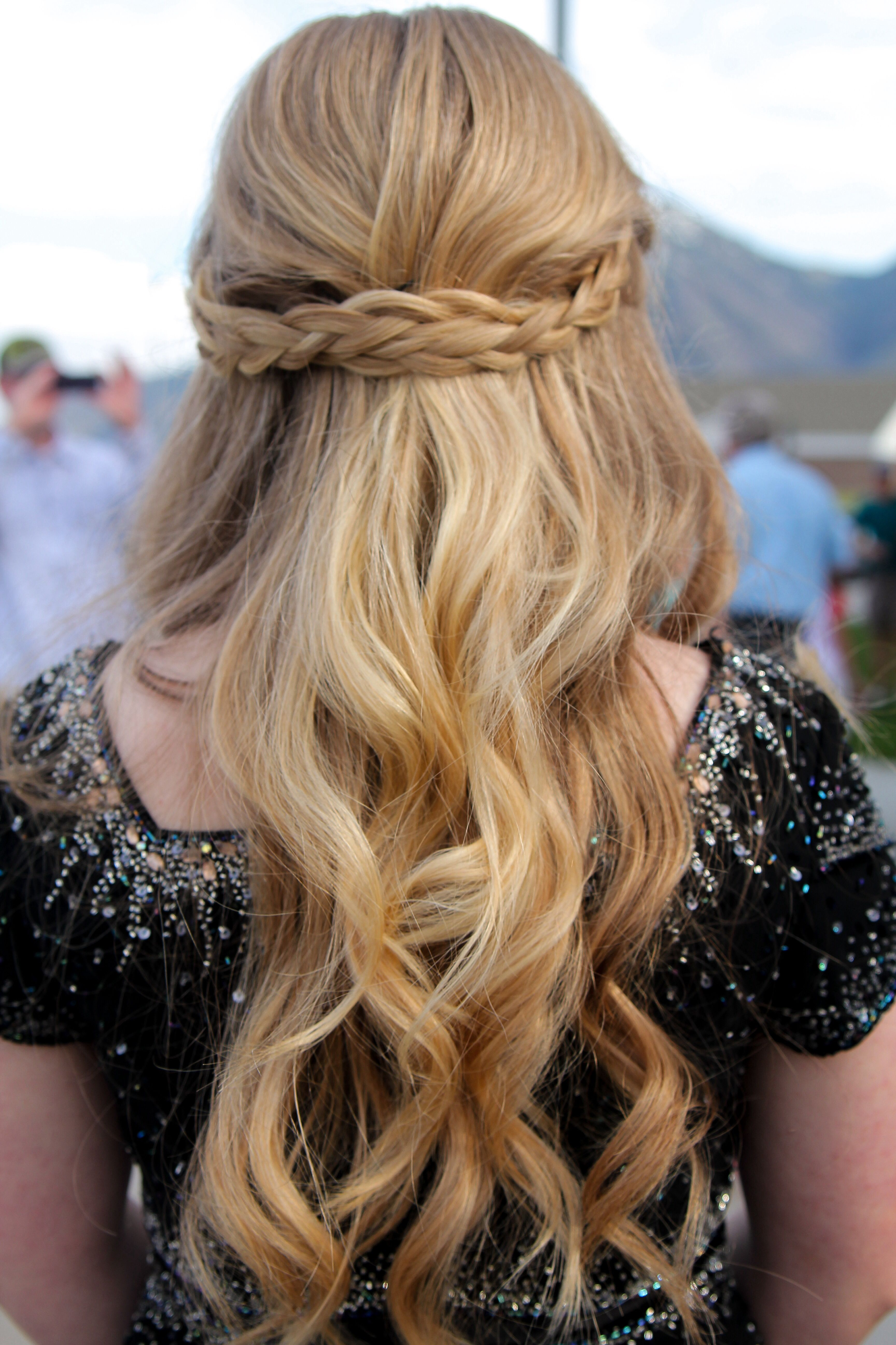 half up half down braided hairstyle. good straight, curly