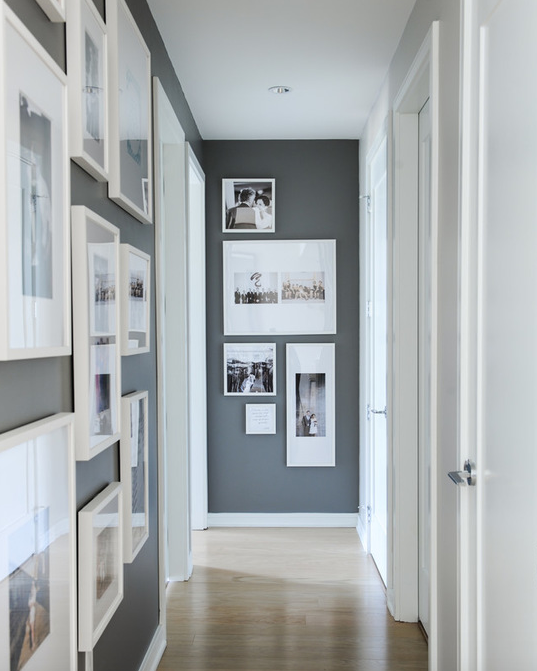 Beautiful Hallway Boasts Dark Gray Accent Walls Painted Benjamin Moore Kendall Charcoal Studded With Photo Gallery Wall In White Frames Across From