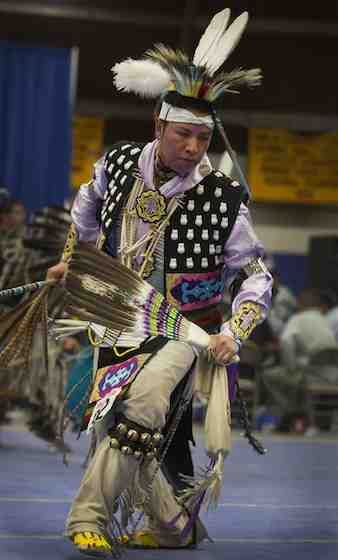 Southern straight dancer Quinton Duran of Fort Defiance, Ariz., dances during the 43rd Annual Diné College Powwow in Tsaile, Ariz., on Saturday night, April 13, 2013. (Diegot James Robles)