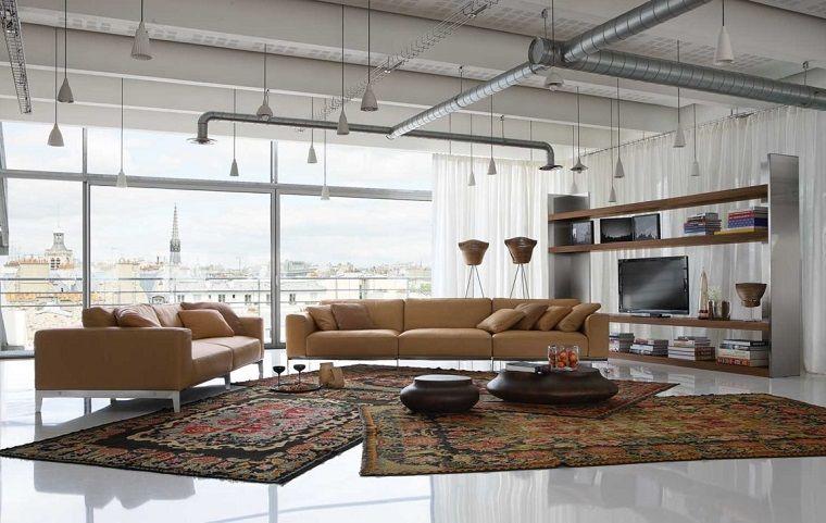 Loft industriale e esempi arredamento soggiorno con divani ...