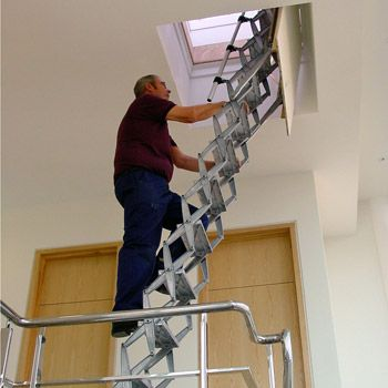 access to roof space via an integral ceiling access panel and retractable ladder http