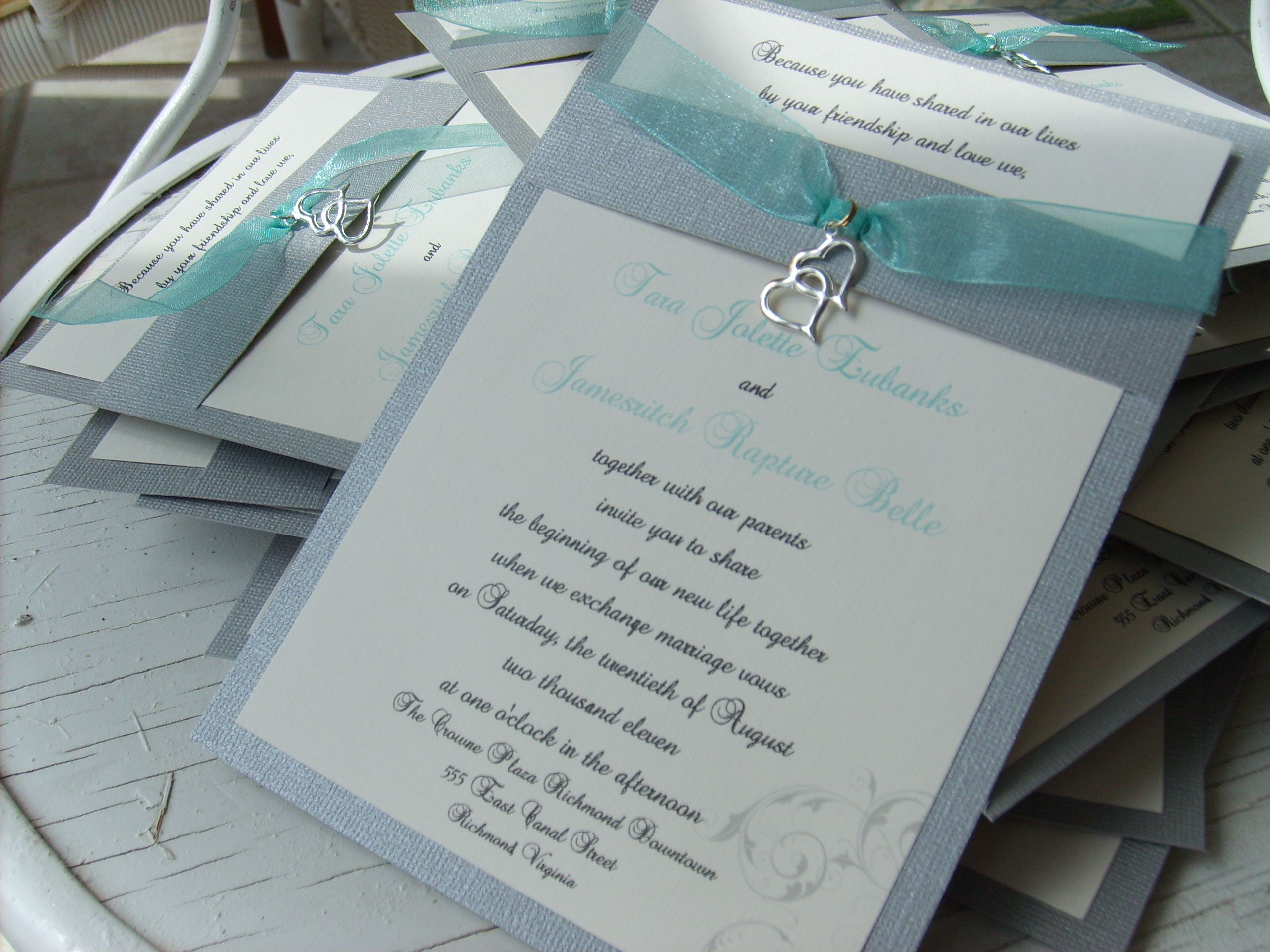 what write on wedding invitation%0A beautiful silver and aqua handmade wedding invitations with double heart  charm from www rubiesandpearlsllc