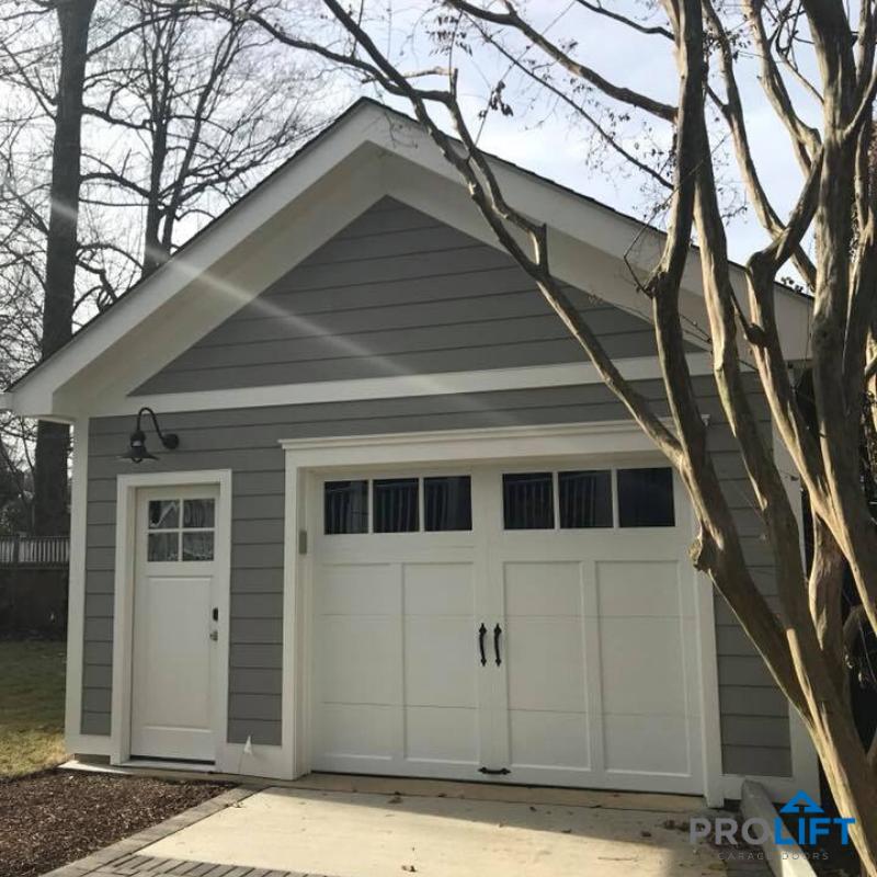 Carriage House Garage Door And Pedestrian Door In 2020 Garage Door Styles Barn Style Garage Doors White Garage Doors
