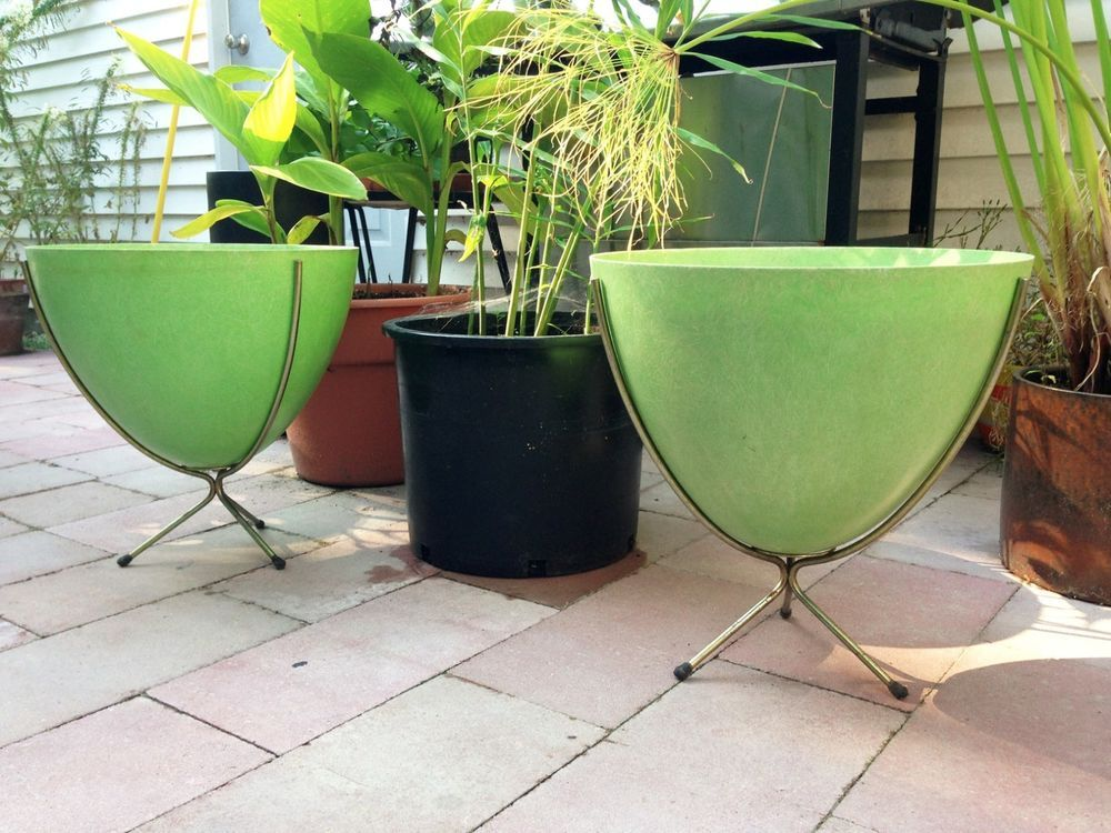 """Up for bid is a stylish 1950s-1960s original mid century modern molded fiberglass bullet planter on brass metal tripod stands. Measures approx 15"""" in diameter x 15"""" tall."""