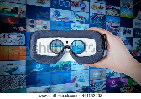 Hand holding virtual reality glasses with streaming multimedia in background