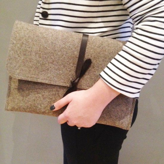 A simple industrial felt and leather laptop sleeve.