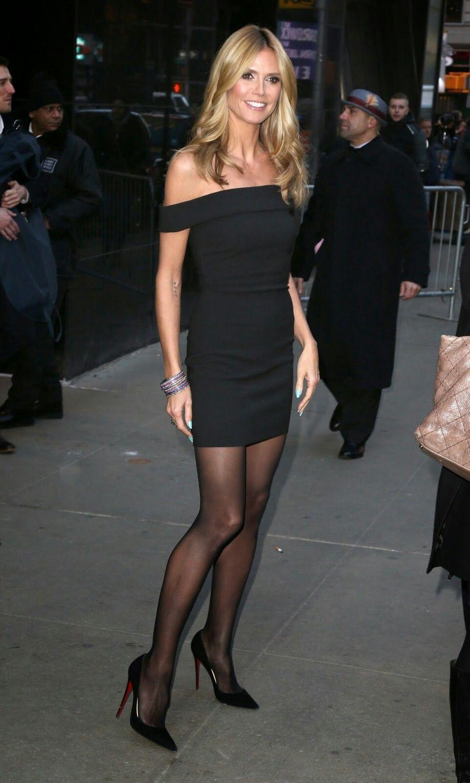 05ceee414b1 Heidi Klum leggy in an off the shoulder little black dress and Louboutin  pumps