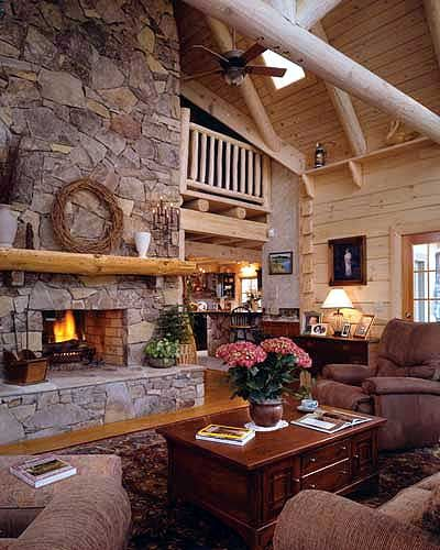 Cathedral Ceiling Of Log Home Living Are In Large With 2 Story Stone Fireplace And Loft