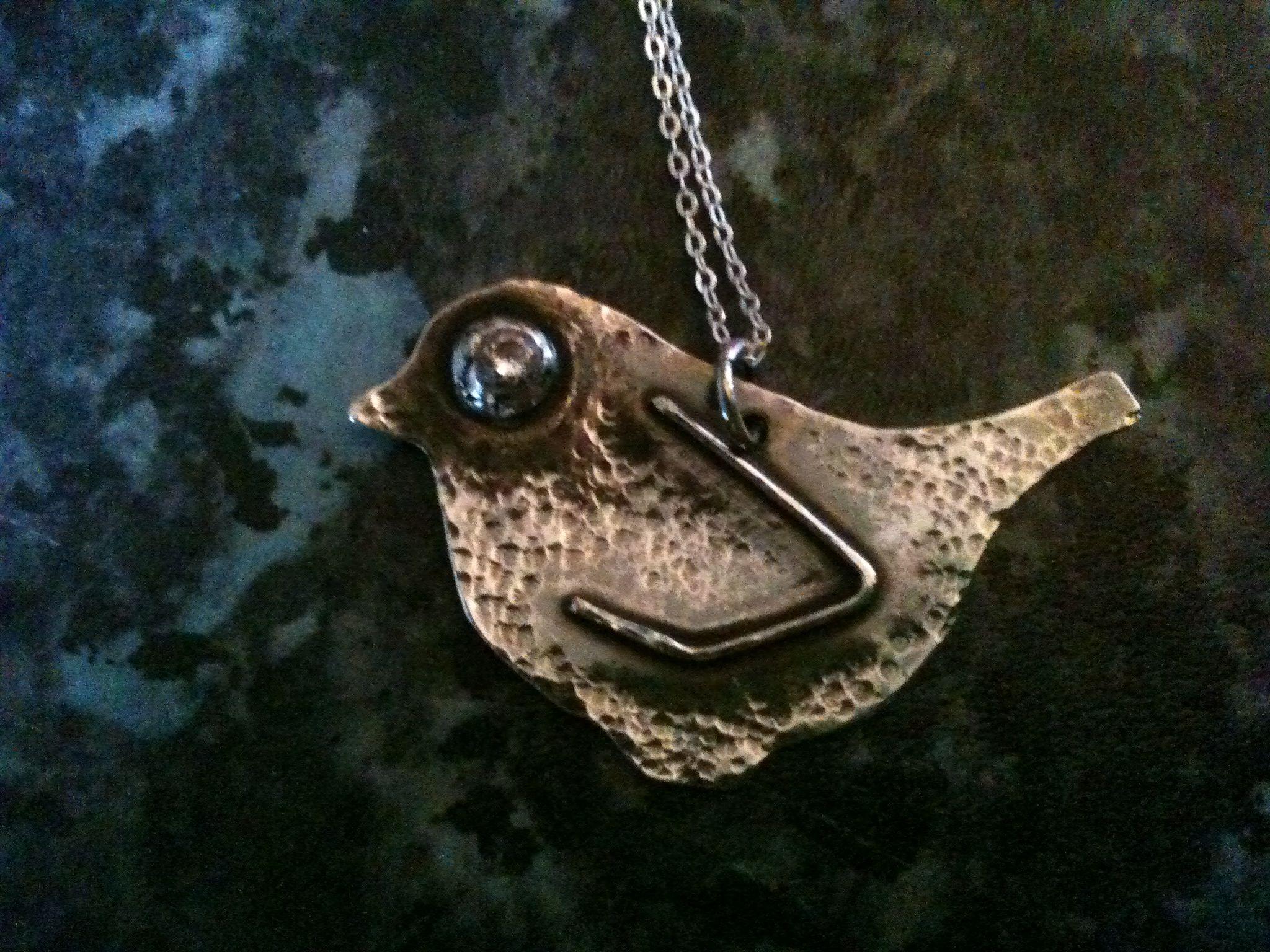 Sterling silver hammered bird pendant.