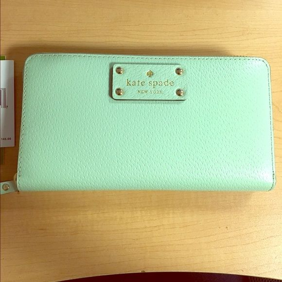 Kate Spade wallet In a super cute mint color. Used maybe 5 times. Very good condition. Inside is super clean like new. kate spade Bags Wallets