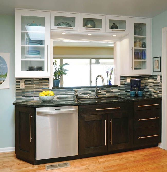Base cabinets feature a rich texture in this kitchen ...