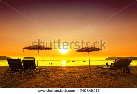 Retro filtered picture of beach chairs and umbrellas on sand at