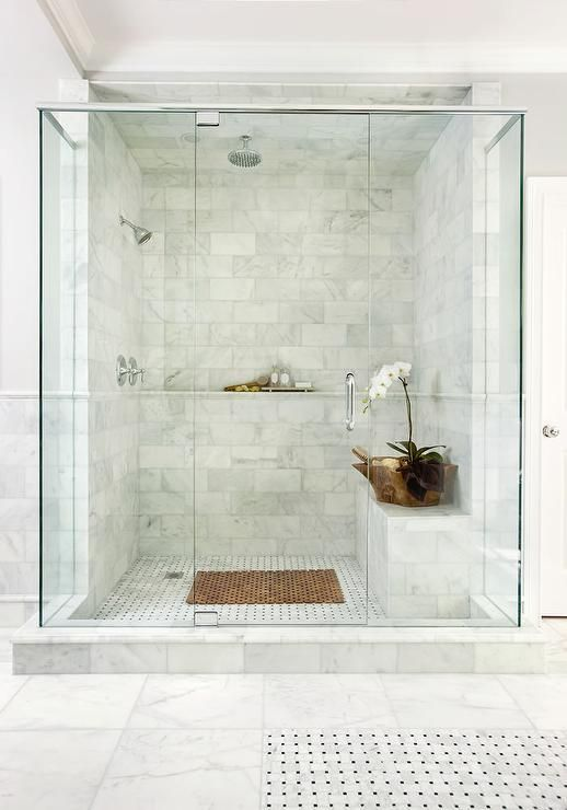 Chic Master Shower Features Ceiling And Walls Clad In Marble Brick