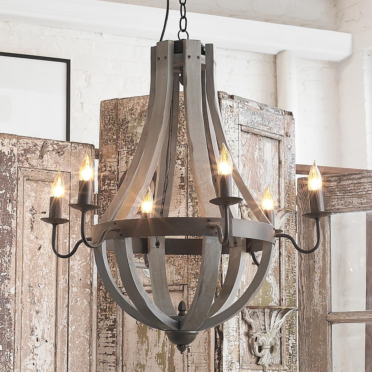 Wooden wine barrel stave chandelier pinterest wine barrel wooden wine barrel stave chandelier inspired by wooden slats from the vineyard this bent wood wine barrel chandelier is strapped with a dark bronze metal aloadofball Gallery