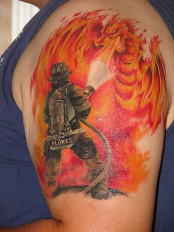 firefighter n flamming dragon tattoo on upper arm. Black Bedroom Furniture Sets. Home Design Ideas