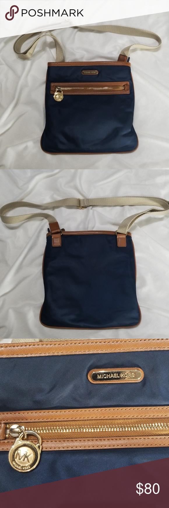 09a362e923dd9b Michael Kors Crossbody Purse Michael Kors Crossbody purse. Navy Blue vinyl with  brown leather trim