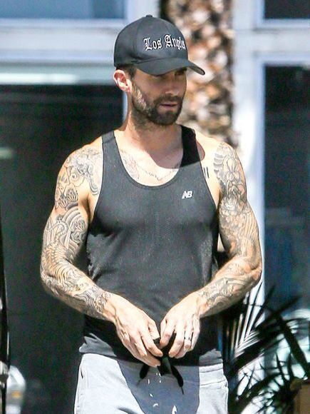 366c5703 Looks like Adam Levine's been hitting the gym! Look at those arms! ❤️