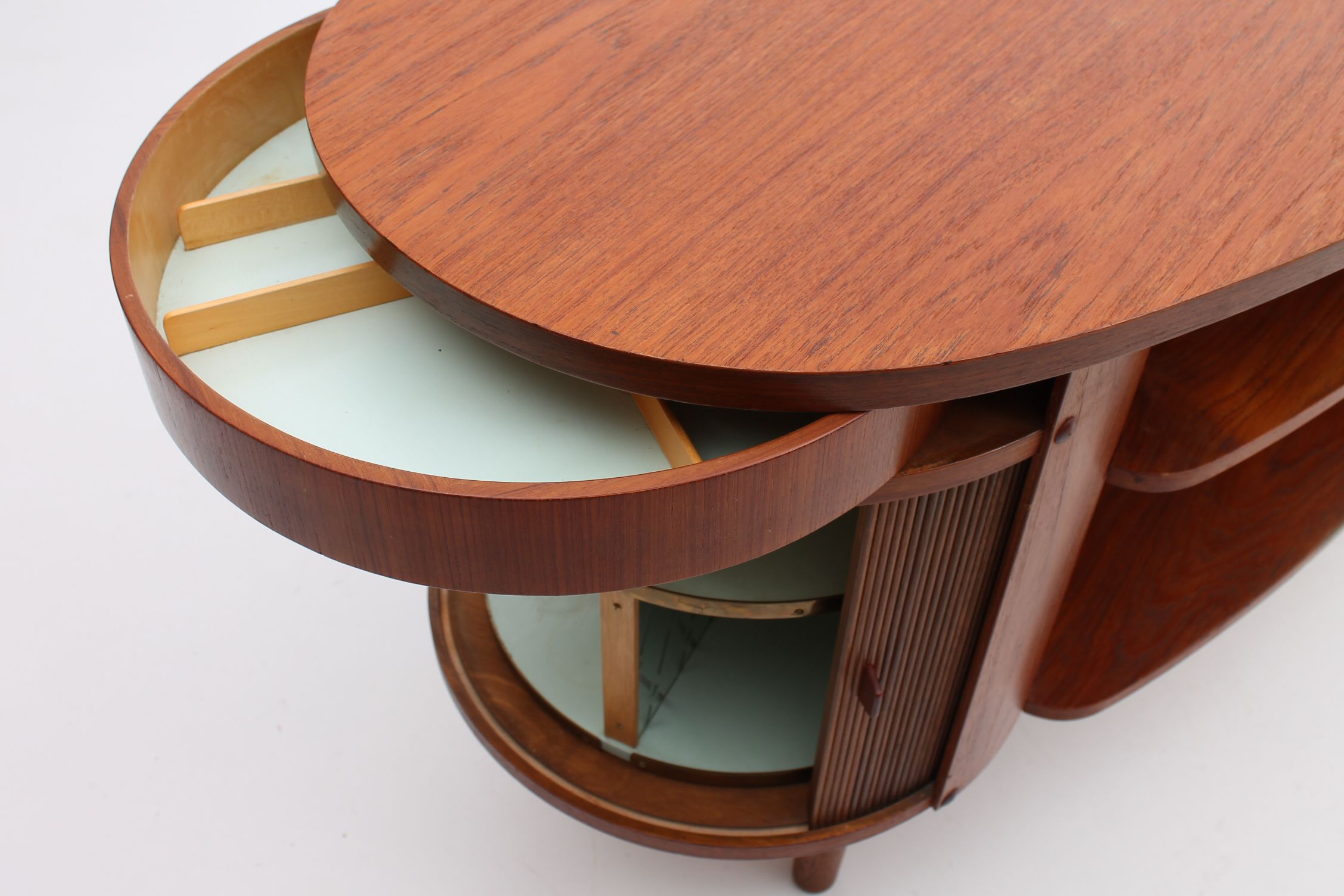 Detail from an organic shaped desk with roll front and spinning