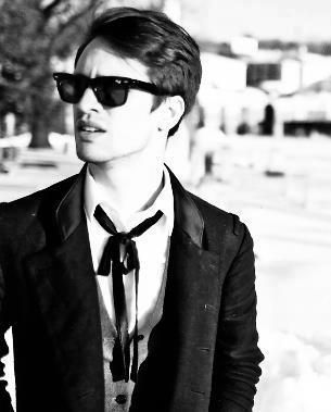 Brendon Urie (Panic at the Disco)....He epitomizes being an amazing musician...I get giddy when I think about seeing him live this summer!! :)