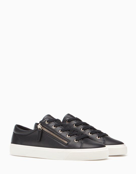 169311ffd9874b Stradivarius black sneakers with zipper.