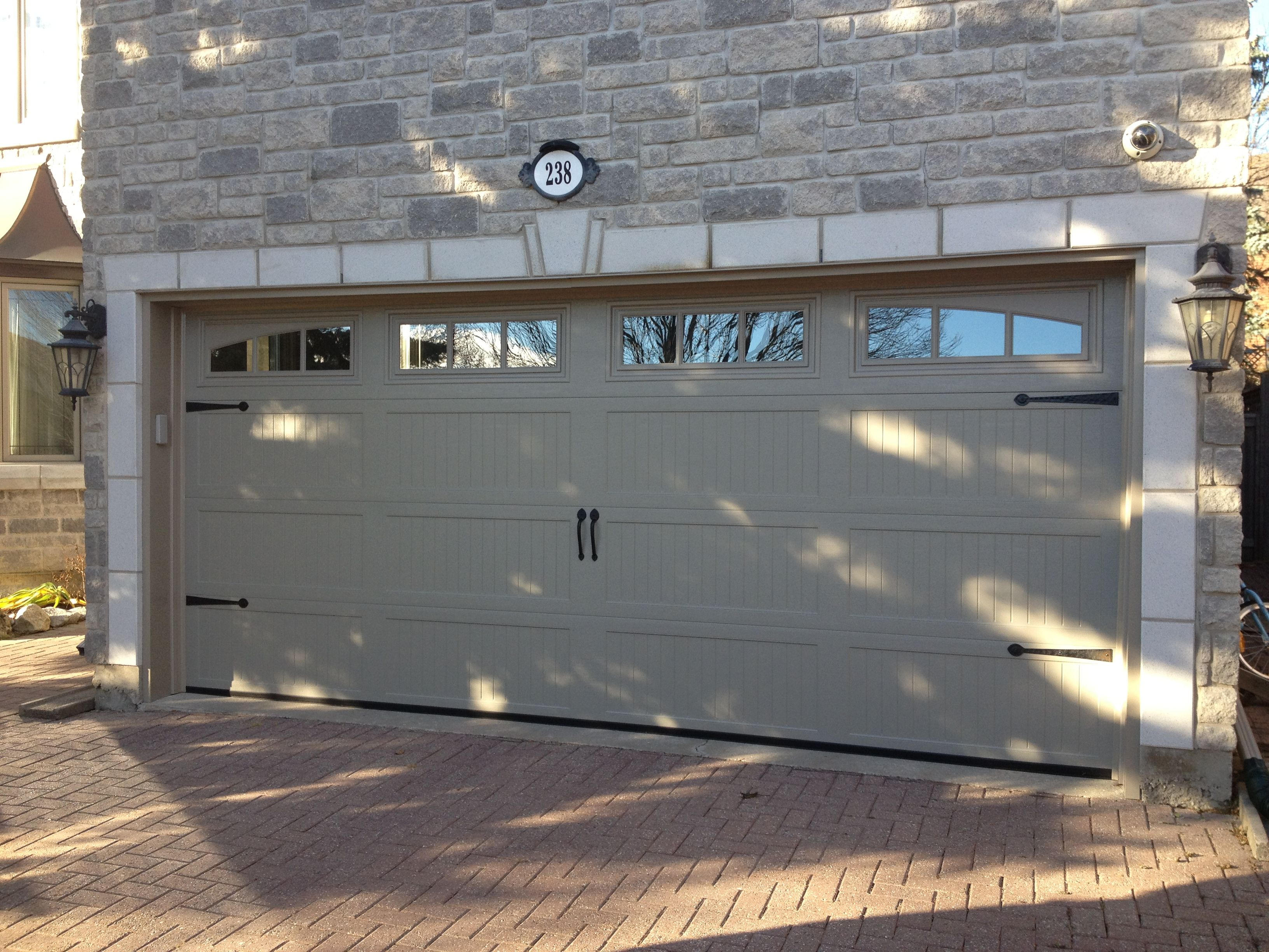 Haas 664 carriage door in sandstone with arched windows for Faux carriage garage door