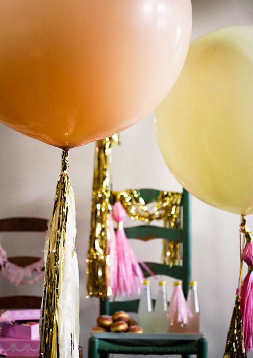 Love the look of adding metallic fringe to balloons!  It would look amazing with white or black balloons and silver or gold fringe!